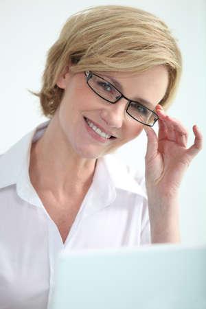 Secretary holding glasses. photo