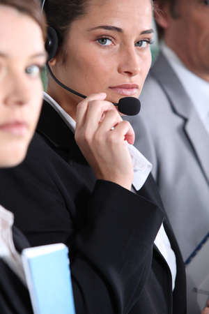 Woman using headset photo
