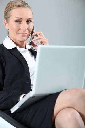 Businesswoman on the phone happy photo