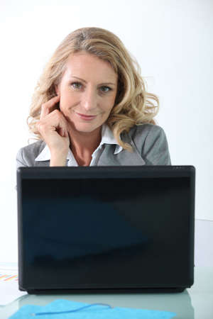 Businesswoman on laptop photo
