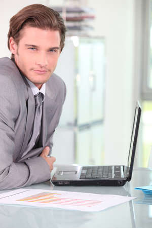Young businessman on laptop photo