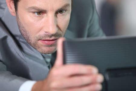 however: Man adjusting screen