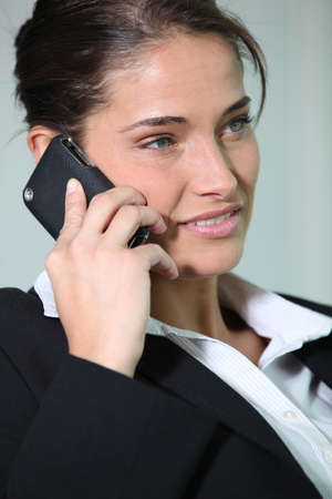 Brunette woman with mobile Stock Photo - 13886029