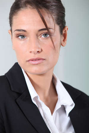 overachiever: Young brunette businesswoman Stock Photo