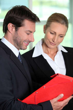 Businessman and woman with folder Stock Photo - 13886109