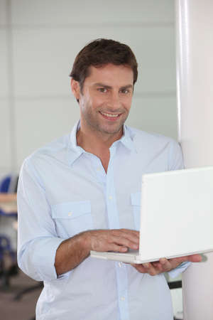 Man with laptop in hand photo