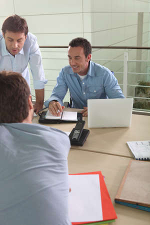 Three male colleagues at work Stock Photo - 13869751