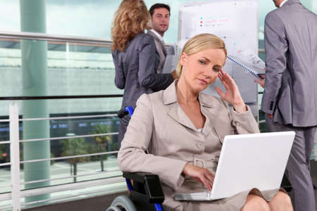 Woman thinking in wheelchair Stock Photo - 13884591