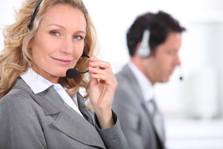 Smiling woman with headset photo