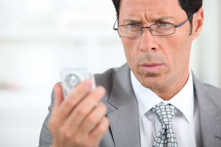 circumspect: businessman looking concerned