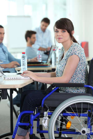 handicapped: Young woman disabled at work Stock Photo