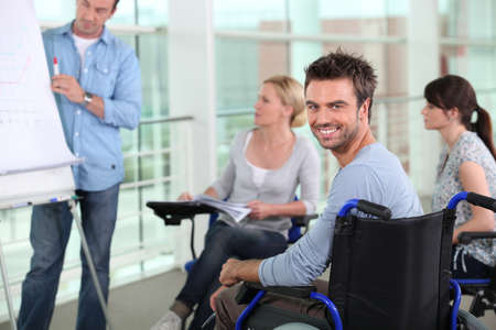flip chart: Man in wheelchair at work Stock Photo