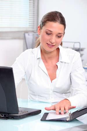 secretarial: Secretary looking at schedule