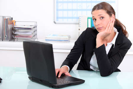 disinterested: Businesswoman bored at work Stock Photo