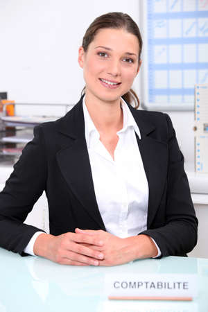 actuary: Smart female accountant sitting at her desk