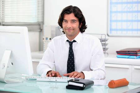 willingness: Black man in office Stock Photo