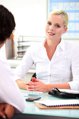 public servants: Meeting with a client Stock Photo