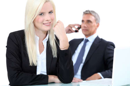 a blonde woman and a mature man well dressed, probably business men Stock Photo - 13817972