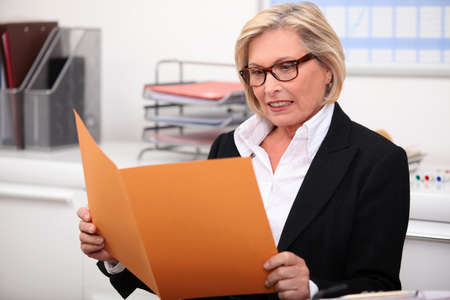 information median: Woman reading report