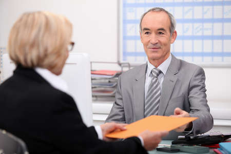 banker: Businessman seeing a client Stock Photo