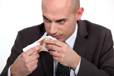 bad man smelling money Stock Photo - 13844102
