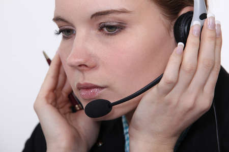 telephone headset: beautiful businesswoman wearing headset