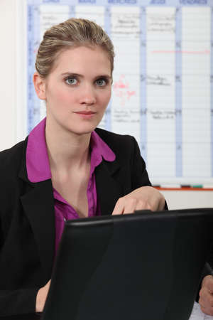 Woman looking up from her laptop Stock Photo - 13844482