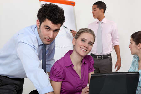 administrators: Businesspeople working together on project Stock Photo