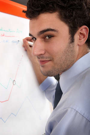 Man writing on a flip chart photo
