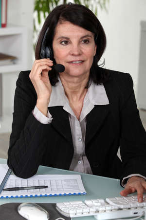 clerical: Portrait of a secretary busy at work Stock Photo