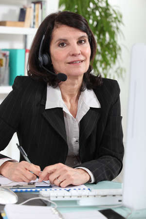 Secretary wearing a headset Stock Photo - 13850343