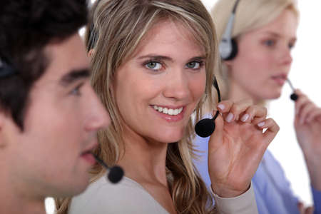 three employees holding headsets photo
