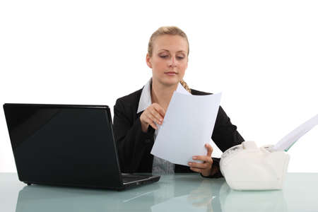 Clerical worker flipping through a document photo