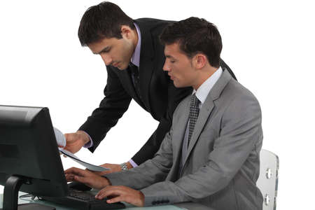 Business professionals working together on a project photo