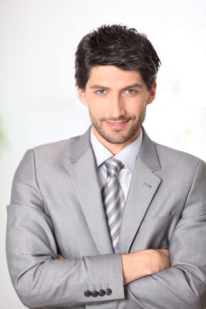 Confident businessman with arms crossed photo