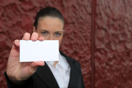 businesswoman holding a visit card Stock Photo - 13844480