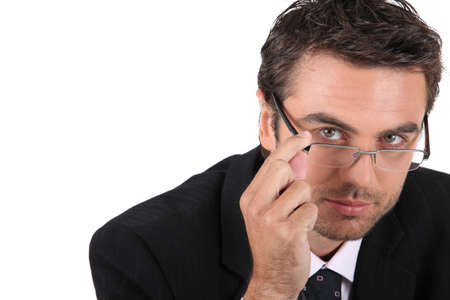 unmask: young man wearing glasses Stock Photo