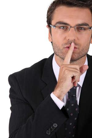 shh: Businessman asking for quiet