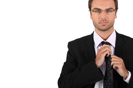 Businessman tying his tie Stock Photo - 13850926