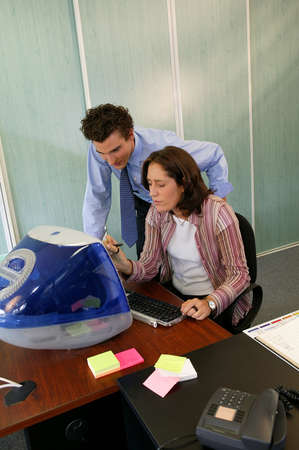 Trainee with manager in front of desktop computer Stock Photo - 13850956