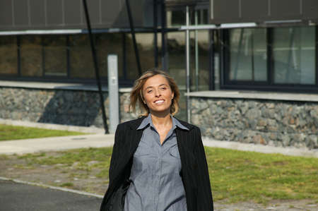 Woman leaving work Stock Photo - 13850920