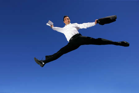 Businessman leaping through the air photo
