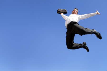 Jonge ondernemer springen in de lucht Stockfoto - 13850925