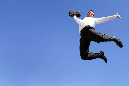 Young entrepreneur jumping in air photo