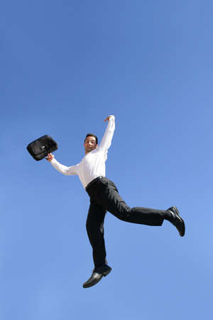 Businessman jumping for joy photo