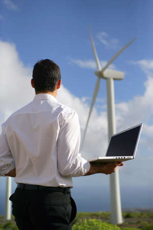 rural development: Man Stood by wind farm