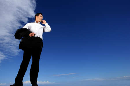 businessman standing in front of sky background Stock Photo - 13845415