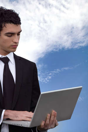 young business man doing computer outside Stock Photo - 13844267