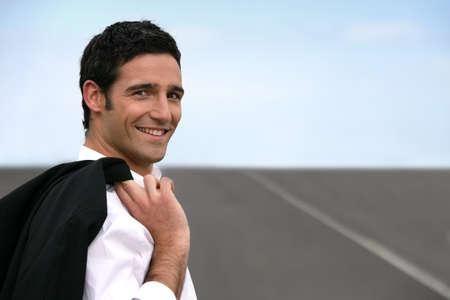 express lane: Businessman stood on empty road