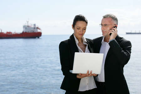 Business professionals lost in the harbour photo